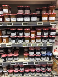 "The many varieties of ""Bonne Maman"" jam in a typical large grocery store."
